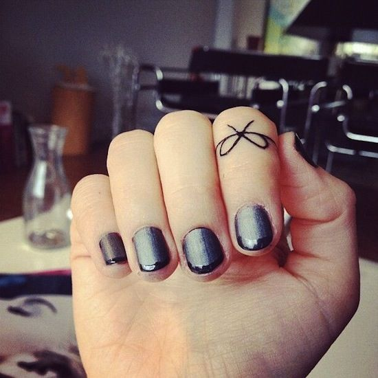 bow on finger small tattoos cute design