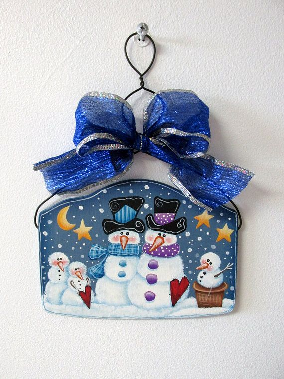 Snowmen Family, Red Hearts, Yellow Star and Moon, Hanging Wired Ornament, Blue Bow, Tole or Hand Painted, Winter Snowmen, Snow Scene, Winter This wired ornament features a beautiful Snowmen Family enjoying a winter day! Great for a fun ornament trade or gift. This design is by