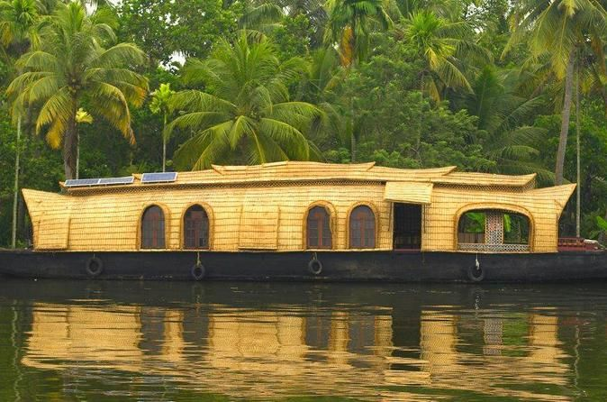 Private Tour: Overnight Kerala Premium Houseboat Backwater Tour in Kumarakom Enjoy this unique private tour on a Premium traditional houseboat or called Kettuvallam rice boat. Your houseboat cruises across backwater of Kumarakom where you experience firsthand the life style of toddy tapping, fishing for small fry, coir-making, prawn farming and more which remains almost the same since the old days. Relax on the houseboat and enjoy tea, snacks and cozy dinner on the Vembanad...