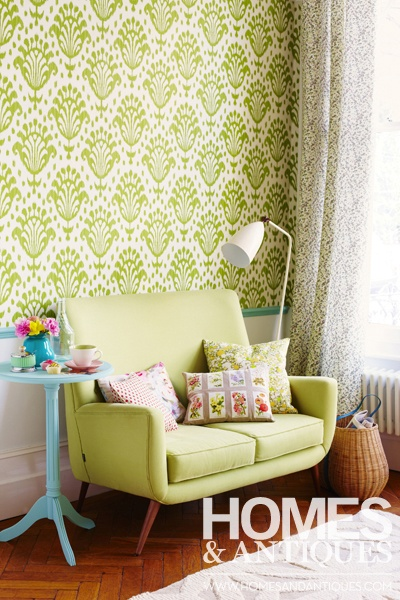Bright wallpaper always lifts a room scheme, but why not go that extra mile? Paint the dado and pieces of occasional furniture too.