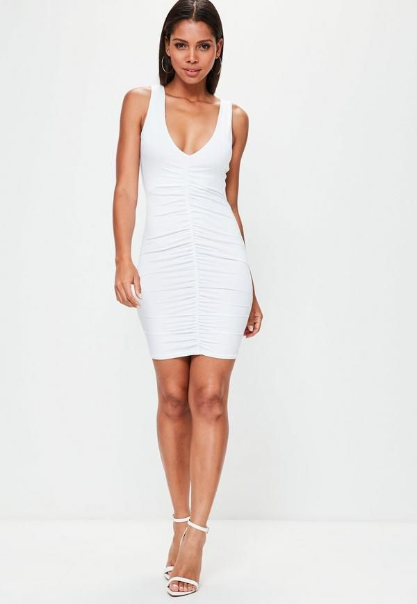Amp up the sass in this all white bodycon dress! With a v neck and ruched fabric to flatter your form, you are sure to score a wardrobe win!