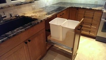 Sammamish Craftsman Style Home - craftsman - Kitchen - Seattle - Tony's Custom Cabinets Pull out recycling bins.