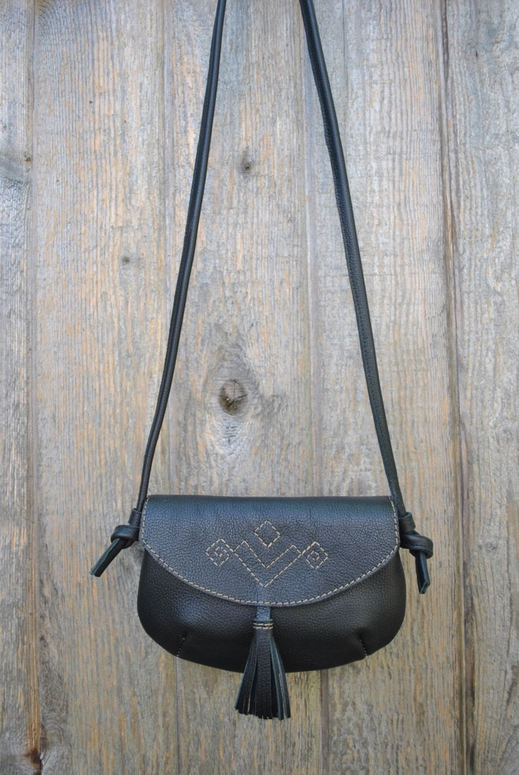 black leather cross body bag with leather tassel by wolfblossomleather on Etsy https://www.etsy.com/ca/listing/454762886/black-leather-cross-body-bag-with