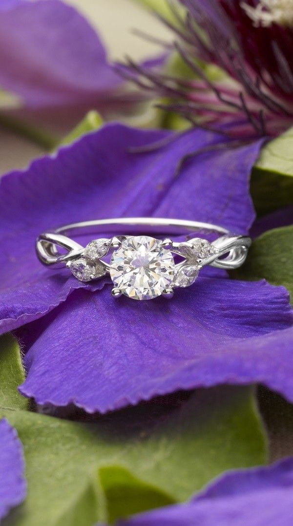 Wispy vines of white gold entwine toward lustrous marquise diamond buds in this nature-inspired trellis ring.