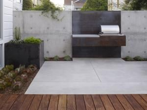 The landscape architect adds a custom-built barbecue unit and dining area to this small backyard behind a townhouse in San Francisco's Noe Valley neighborhood.