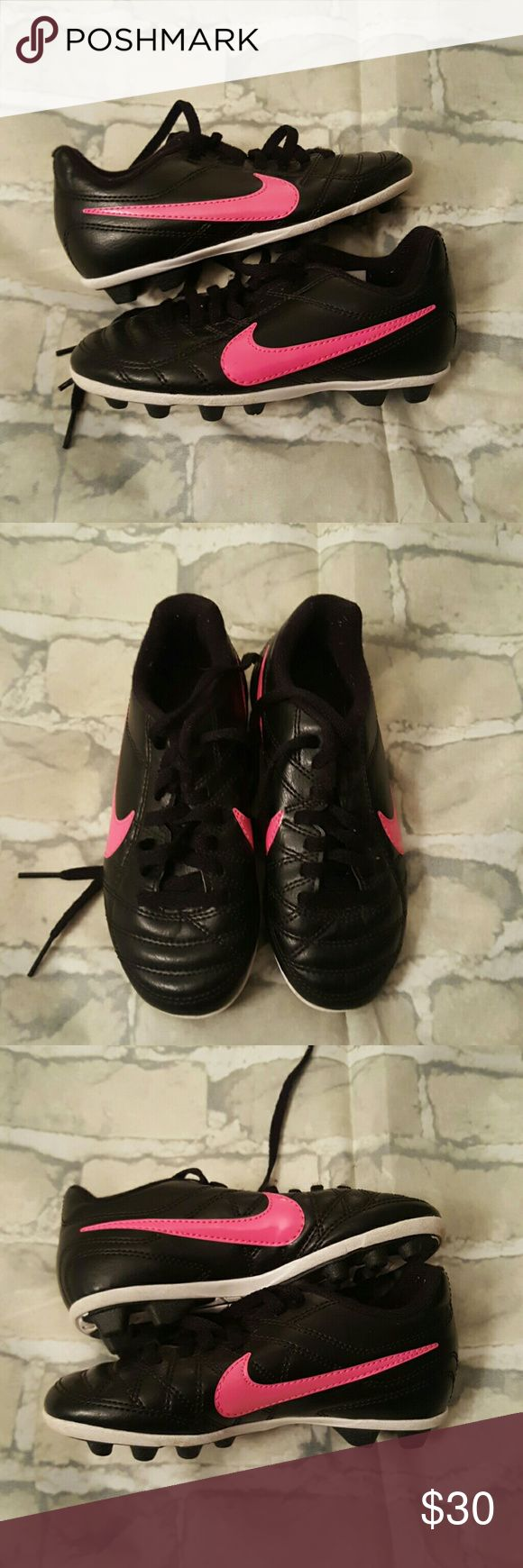Toddler nike cleats Size 11c. Black pink and white. Gently used. Like new condition Nike Shoes