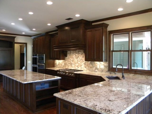 granite kitchen lights over table bianco antico with dark cabinets dining room countertops