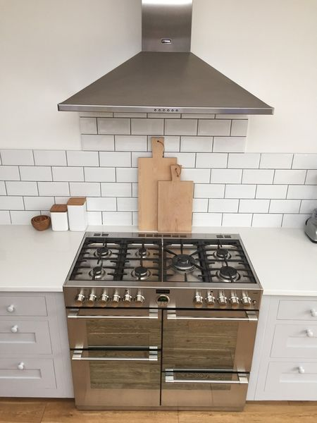 Anita's stunning Stoves Sterling range cooker and hood in stainless steel - a true style statement in this bright white and metallic kitchen!