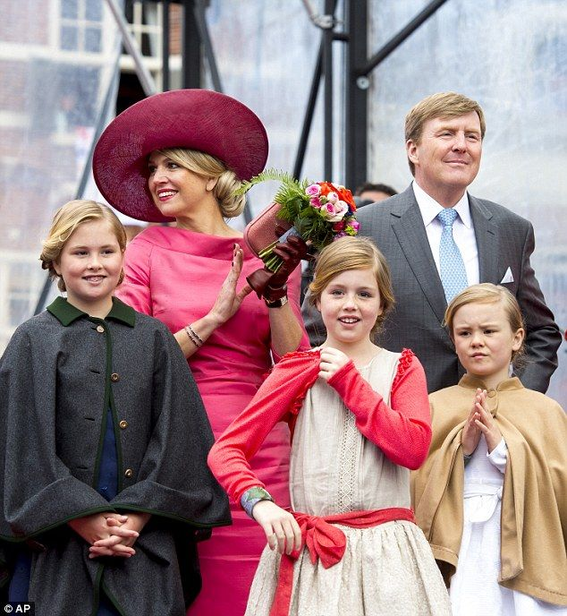 Round of applause: The Queen and the princesses join in with a round of applause for Willem-Alexander