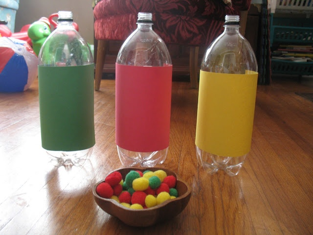 totally doing this with smaller water bottles.  we can do all things: Fine Motor Sorting