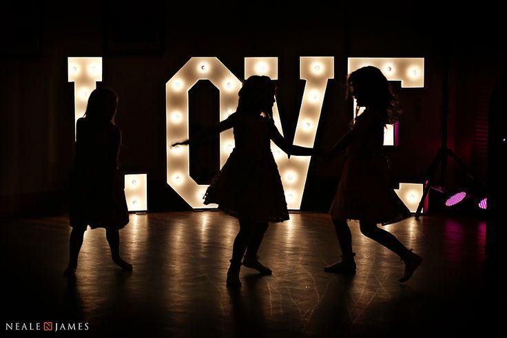 Illuminated LOVE signs at Mythe Barn