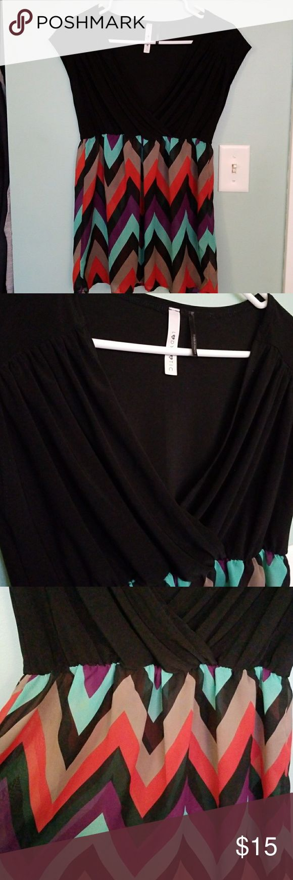 V-neck black and chevron top V-neck black and multi color chevron top.  Size medium, bottom is flowy for flattering fit.  Bottom half of shirt is shear.  Great condition, no tears, stains or holes. Lady Matic Tops Blouses