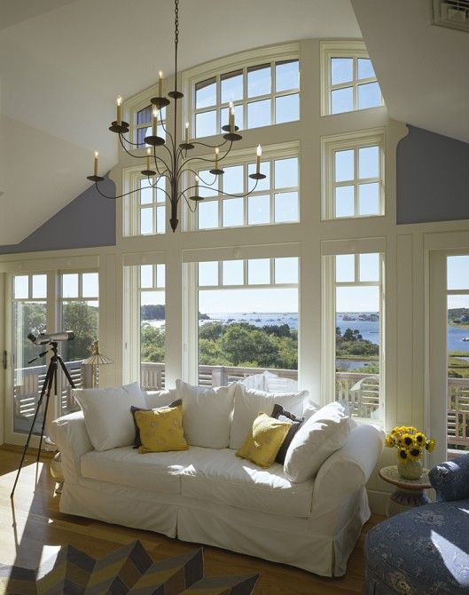 Beach house: white sofa; pillows; chandelier