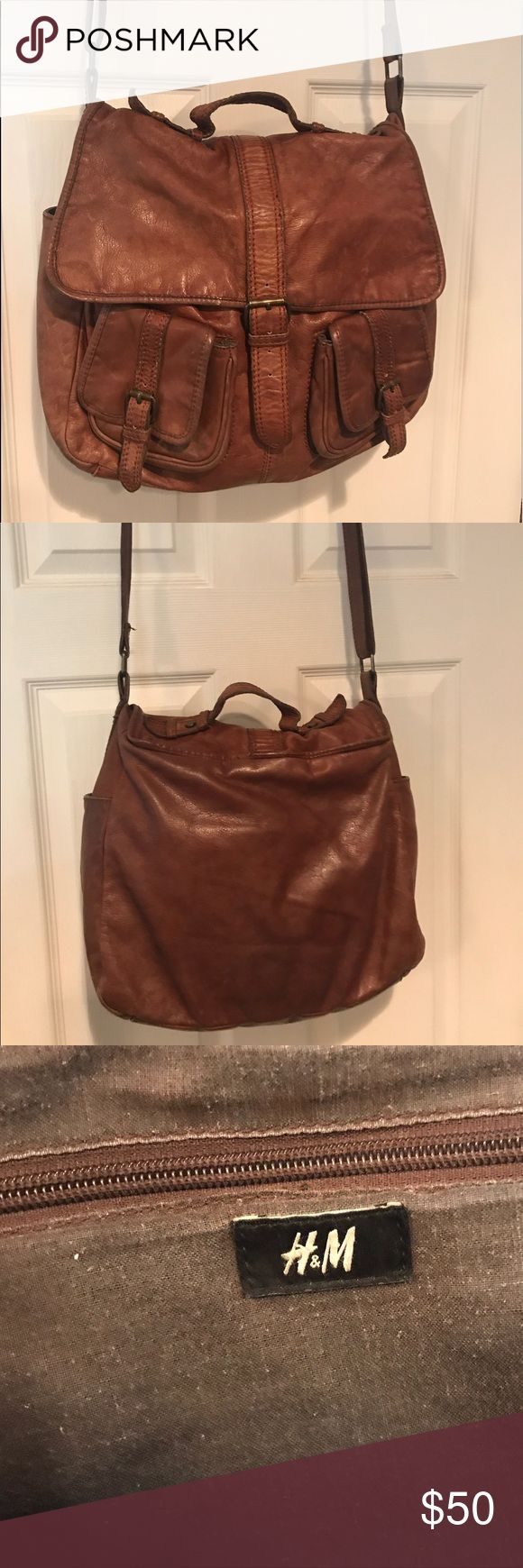 H&M Brown leather cross body purse This brown leather H&M purse is perfect for the summer. It is over the shoulder which makes a life on the go easier. Plus it is an absolute adorable style that has always been a fashionable statement. The inside is clean with a zipper pocket and more. The shoulder strap has a belt look and is adjustable. The top of the bag loops over which keeps your valuables safe inside from theft. It has enough room for an iPad which can be great for school, day to day…