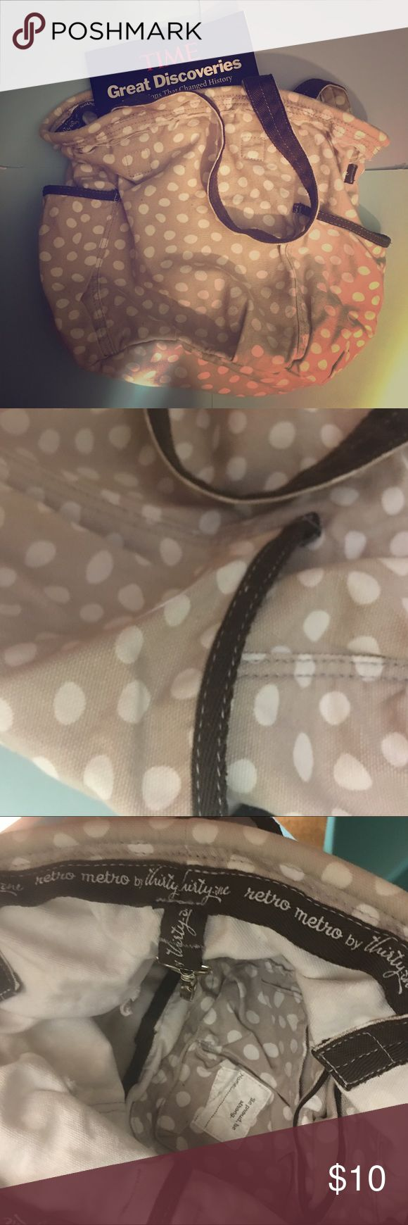 """Tan Thirty-One Retro Metro Tote Canvas material- Tan with white dots- Retro Metro Tote """" could be bucket purse or small tote. Multiple inside pockets & hook inside to attach car keys, etc  Good used condition 31 Gifts Bags Totes"""