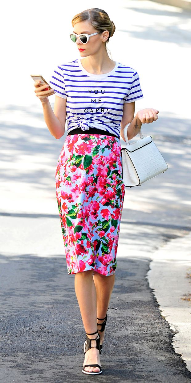 Jaime King in a striped tee, floral print skirt, and black heels