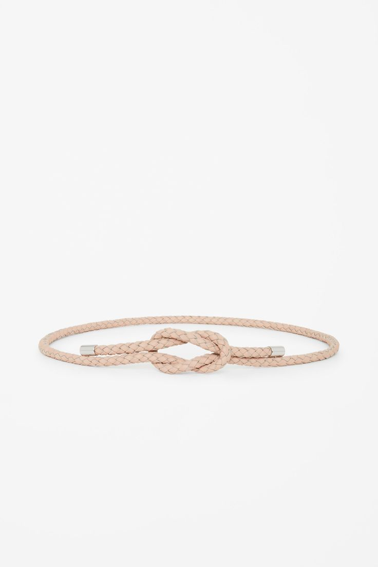 Made from tubular leather rope with a braided finish, this long belt is designed…