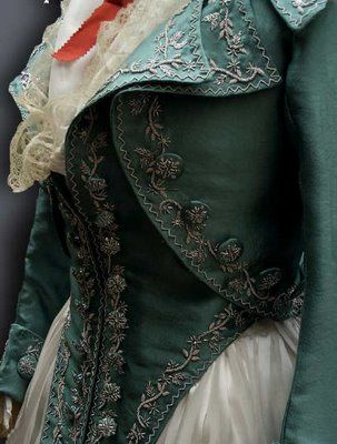"""Toward the 1770s, an informal alternative to the gown was a costume of a jacket and petticoat, based on working class fashion but executed in finer fabrics with a tighter fit. The Brunswick gown was two-piece costume of German origin consisting of a hip-length jacket with """"split sleeves"""" (flounced elbow-length sleeves and long, tight lower sleeves) and a hood, worn with a matching petticoat. The caraco was a jacket-like bodice worn with a petticoat, with elbow-length sleeves."""