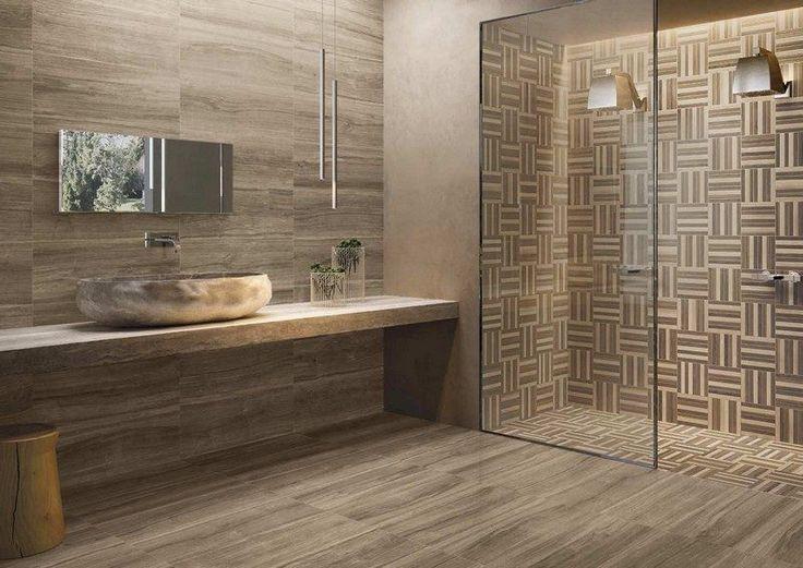 salle de bain moderne avec un carrelage mural et de sol aspect bois, une vasque ovale en pierre naturelle et une cabine de douche moderne