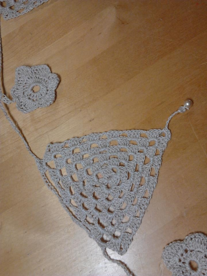 My crochet bunting.  Flags and flowers made with crochet cotton