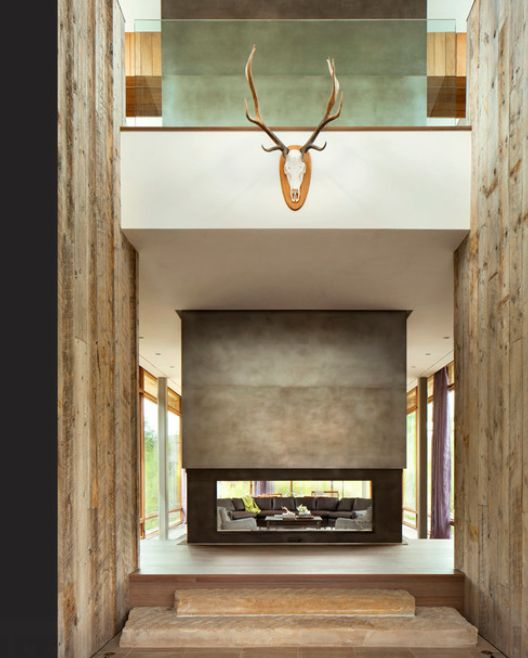 he large raw steel form is a chimney suspended over an open fireplace an acid