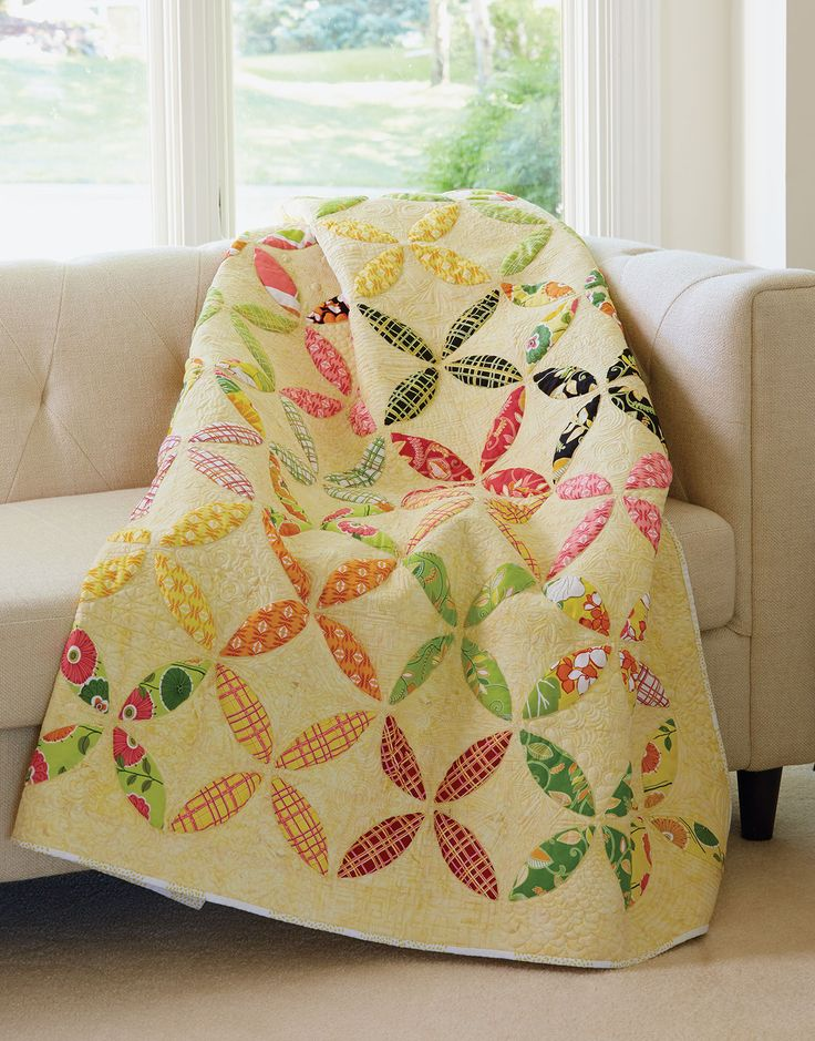 CITRUS SIZZLER by Diane Fama: If you like traditional quilts like the Orange Peel quilt pattern or star quilt blocks, then the Citrus Sizzler Quilt is perfect for you! Designer Diane Fama took the traditional Orange Peel pattern and updated to create a quilt of sunny tropical prints. Our Sew Easy instructions for Windowing Fusible Applique help you pull the blocks together with ease.