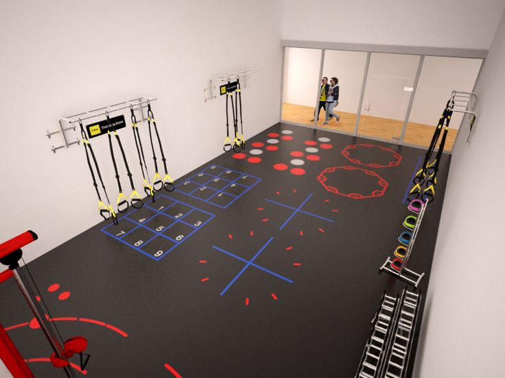 Top right front view of a racquetball court upgrade conversion in a health club into a functional training space.