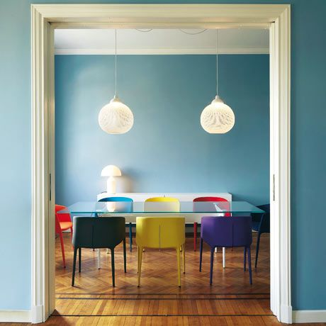 This 1920s Milan apartment is all clean lines, quiet minimalism and strong colour. Housed in a terracotta-red, neoclassical block in Milan by Italian architect Gio Ponti, the apartment was renovated by designer Sezgin Aksu after remaining unchanged for 80 years. This room contrasts warm parquet, cool walls and pop art chairs.