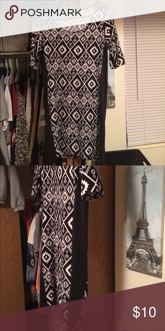 Black and white Aztec dress Quarter sleeve dress. Extremely comfortable material. (Polyester and spandex) black stripe up both sides. great for a night out or just a casual spring/summer day. Rue21 Dresses Midi
