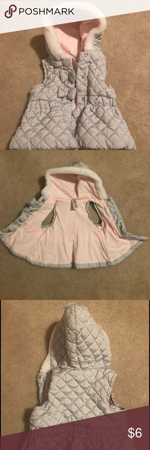 Silver Vest trimmed with bows and faux fur trim Silver Vest trimmed with bows and faux fur trimmed hood! Inside is lined in pink. Perfect for fall with easy transition to the winter season. Great for layering! Just a great piece for your little one! Jackets & Coats Vests