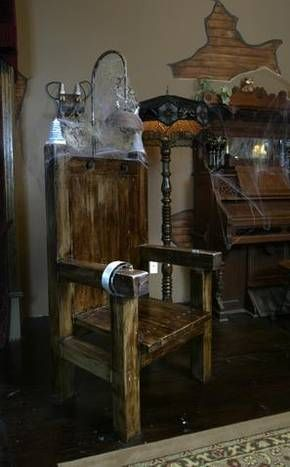 Charles McKee built the faux electric chair, which serves as a focal point of the living room.