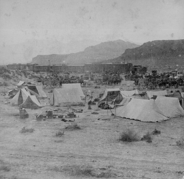 Campsite and train of the Central Pacific Railroad at the foot of the mountains, 1868