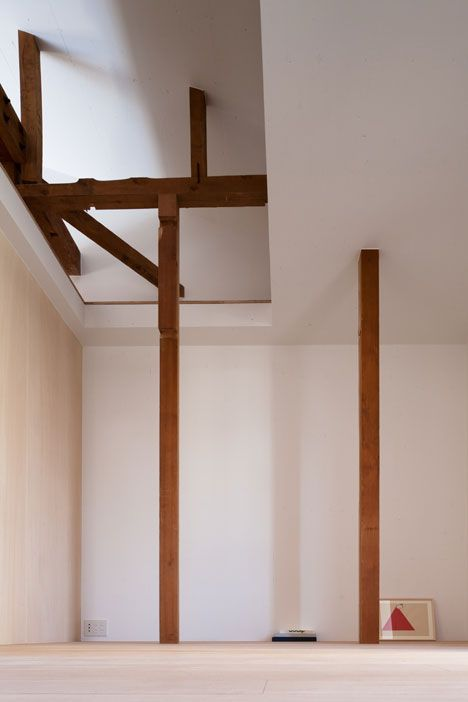 Wood structures interface idiosyncratically with the minimalist spaces in this house project by Shimpei Oda.