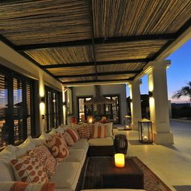 tropical outdoor living space - great choice of fabric pattern teams so well with timber ceiling and venetian blinds