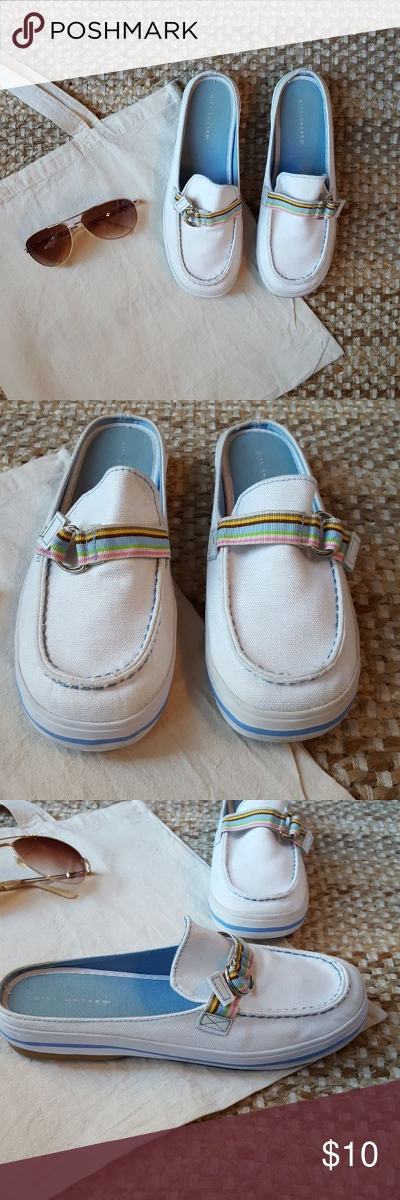 Women's canvas boat shoes White with multicolored strap. Slip on. Only worn a handful of times. Still have some fabric on soles that haven't worn off. Canvas top is still very white with little signs of wear. Size 6.5 but I usually wear a 7 and they fit just fine. City Sneaks Shoes Flats & Loafers
