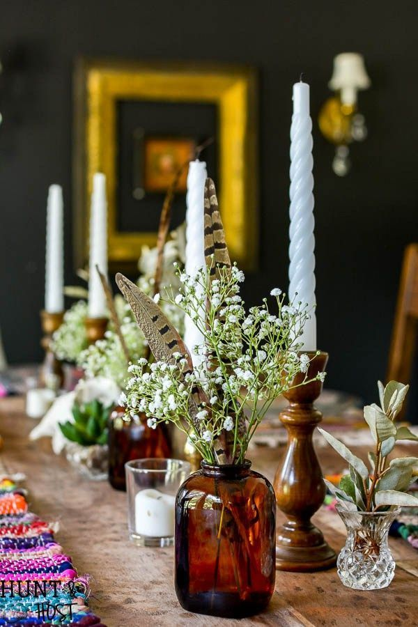 Fall table Boho table perfect for a fall centerpiece or any time of year, brown bottles, feathers and gorgeous bright placemats!