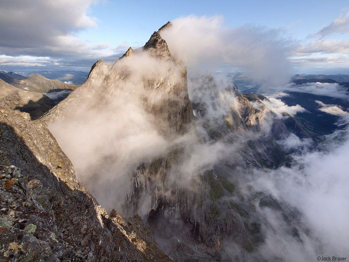 Storm clouds clear off the massive Trollveggen face, as seen from the top of the Trollstinden, far above the Romsdalen valley near Andalsnes.