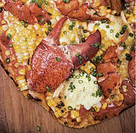 The rich and decadent ingredients assembled here create a luxurious pizza that Donald Trump would be proud to serve at his Fourth of July party. If you can't find lobster in your market, buy frozen cooked crayfish; it makes a tasty and economical substitute. You can use store-bought pizza dough or make your own.