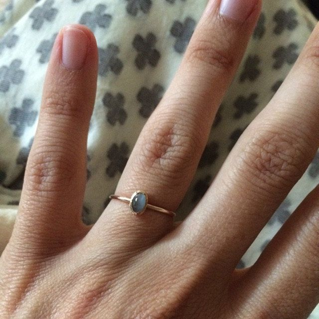 I'm planning on stacking this ring with other engagement/wedding rings. It looks beautiful and is my son's birthstone. It's a beautiful bluish green color. I had him set the stone a little higher so it would stack nicely. Working with him was great. It arrived to San Francisco quickly and without any problems or fees.