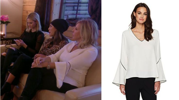 Bell of the blouse! Get info on Vicki Gunvalson's White Contrast Trim Blouse in Iceland here: https://www.bigblondehair.com/vicki-gunvalsons-white-bell-sleeve-top/ #RHOC Real Housewives of Orange County Fashion