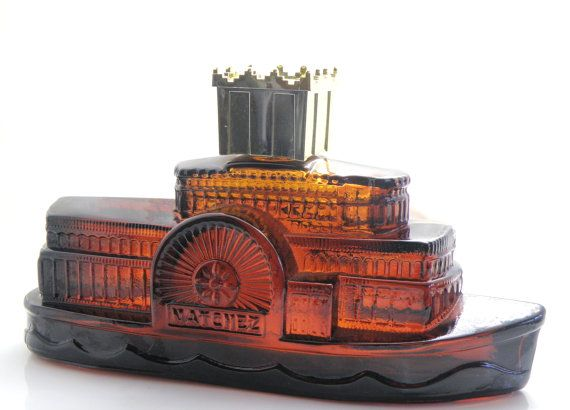 Amber bottle Natchez Steamship paddle steamer! Canadian Customers also get the 4 fluid ounces Avon Wild Country aftershave. US, bottle only.