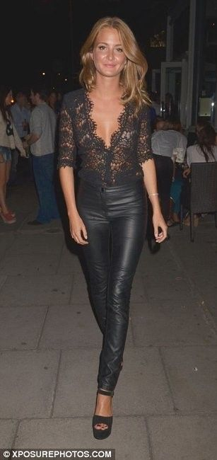 Millie Mackintosh in black lace top from The Kooples and Kurt Geiger heels.