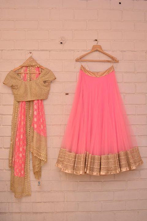 Baby pink tulle light lehenga with gold blouse
