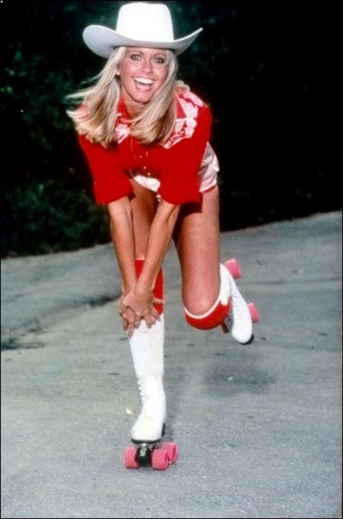 Olivia Newton-John on rollerskates. hat