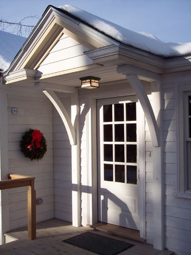 Custom made portico brackets support this greek revival for House brackets