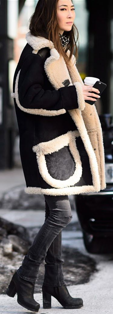 The Shearling Coat: Jayne Min is wearing a coat from Coach