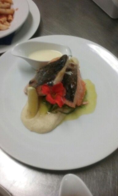 Salmon and Pollack duo. Honey roasted parsnip puree..on bed of garlic juillene of leek..lemon butter sauce..extrusion flower