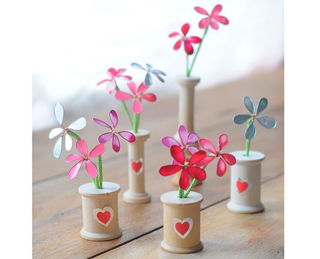 Nail Polish Flowers made with wire and nail polish! Click here for the very easy tutorial. Vase made from wooden spool! #nailpolish #flower