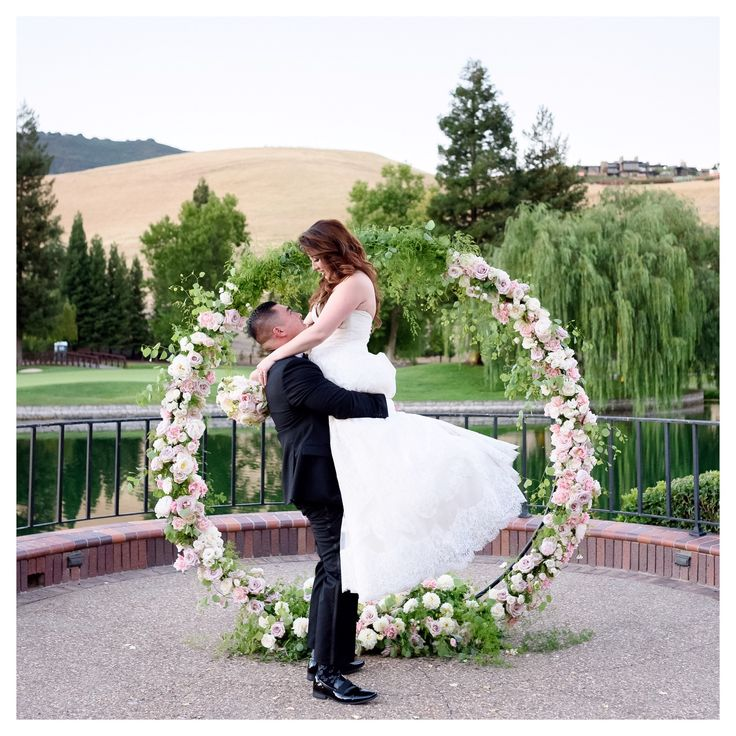 Circle of love round arch + lake backdrop made the ceremony like a fairytale dream come true.
