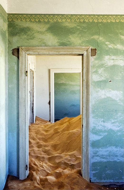 This is a ghost town in Namibia called Kolmanskop. The town was abandoned and now the sand has taken over some of the buildings. I loved the colors in this photo.